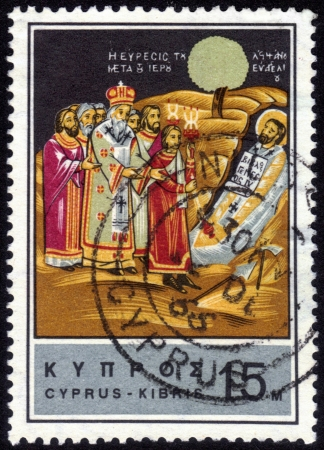 CYPRUS - CIRCA 1966: A stamp printed in Cyprus shows an image of the religious scene The discovery of the body of Saint Barnabas, circa 1966. photo