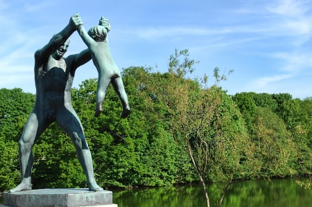 sculpture of a man playing with a child in the Vigeland park, Oslo