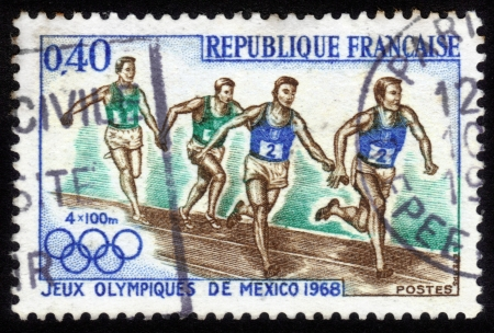 France - CIRCA 1968  a stamp printed by France shows athletes runners  Olympic Games in Mexico City in 1968, circa 1968