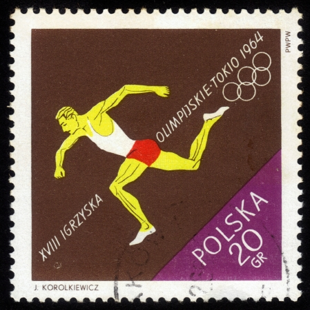 POLAND - CIRCA 1964  a stamp printed by POLAND shows the running athlete, Series, circa 1964 Stock Photo - 14564787