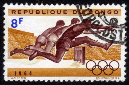 The Republic of Congo - CIRCA 1964  a stamp printed by the  Republic of Congo shows the competition in running with the barriers for men, circa 1964 Stock Photo - 14564785