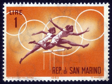 The Republic of San Marino - CIRCA 1963  a stamp printed by the Republic of San Marino shows the competition in running with the barriers for women, circa 1963 Stock Photo - 14565486