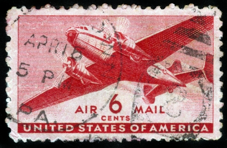 UNITED STATES OF AMERICA - CIRCA 1950s: A stamp printed in the USA shows two engine transport plane, circa 1950s Stock Photo - 14602277