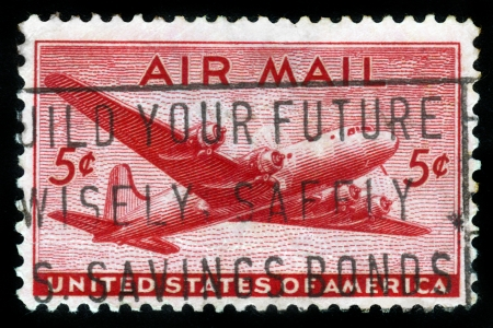 UNITED STATES OF AMERICA - CIRCA 1950s  A stamp printed in the USA shows the four engine transport plane, circa 1950s Stock Photo - 14616531
