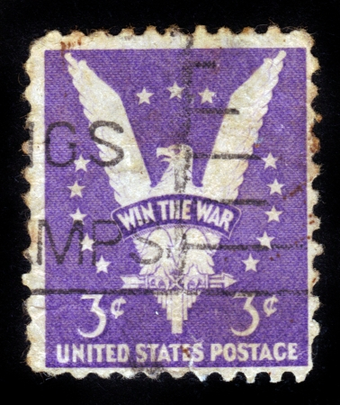USA - CIRCA 1942  A Stamp printed in USA shows the American Eagle, with the inscription WIN THE WAR, circa 1942 Stock Photo - 14616526