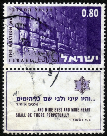 ISRAEL - CIRCA 1967: A stamp printed in the Israel shows image of the Western Wall in Jerusalem, an inscription in English and Hebrew - My eyes and my heart there at all times , circa 1967 Stock Photo - 14720194