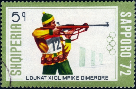 ALBANIA - CIRCA 1972: A stamp printed in the Albania (Shqiperia), shows biathletes at the Winter Olympics in Sapporo, Japan, circa 1972 Stock Photo - 14720186