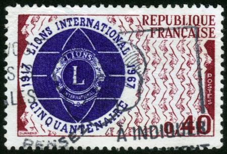 FRANCE - CIRCA 1967  a stamp printed in the France shows  Emblem of Lions Clubs International  LCI  , 50th Anniversary of Lions International, circa 1967 Stock Photo - 14720189