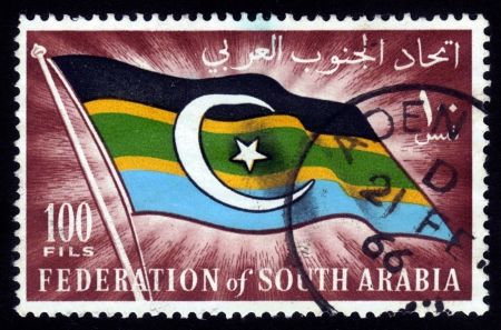 South Arabia - CIRCA 1966  A stamp printed in Federation of South Arabia shows the image of the national flag of Federation of South Arabia, circa 1966 Stock Photo - 14720190
