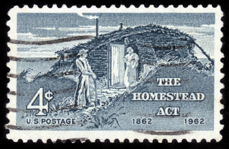 USA - CIRCA 1962  A stamp printed in USA shows the Sod Hut and Settlers, Homestead Act Centenary, circa 1962 Stock Photo - 14720201