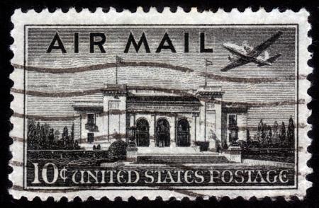 UNITED STATES OF AMERICA - CIRCA 1947  a stamp printed in the United States of America shows plane over Pan American Union Building, Washington, DC, circa 1947 Stock Photo - 14720188
