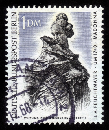 Germany - CIRCA 1968  A stamp printed in Germany shows a portrait of madonna by Joseph Anton Feuchtmayer, circa 1968 Stock Photo - 14720185
