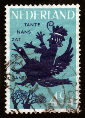NETHERLANDS - CIRCA 1963  A stamp printed in the Netherlands shows an illustration of a child s poem about Aunt Nance, circa 1963  Stock Photo - 14720184