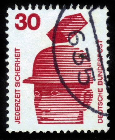 GERMANY - CIRCA 1971  A stamp printed in Germany shows Safety helmets prevent injury, series, circa 1971 Stock Photo - 14720174