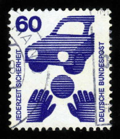GERMANY- CIRCA 1971  stamp printed in Germany, shows Traffic safety  ball rolling before car ,  is dedicated to Accident prevention , circa 1971 Stock Photo - 14720175