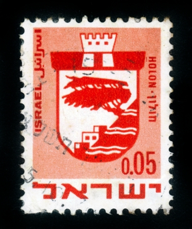 ISRAEL - CIRCA 1960: A stamp printed in Israel, shows coat of arms of Holon ,  Israel, series , circa 1960 Stock Photo - 14720196