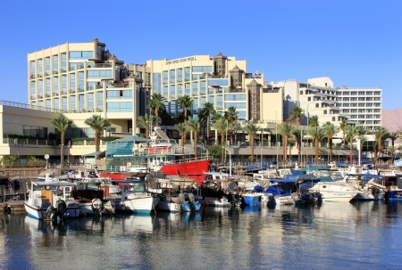 View on marina and moored yachts and boats and modern hotels in popular resort  - Eilat of Israel