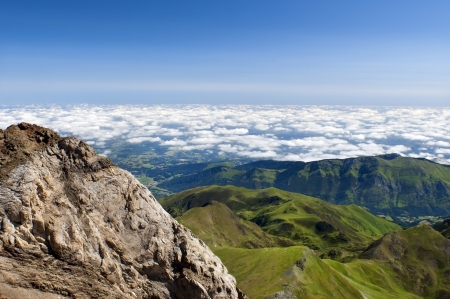 Standing on top of the Pyrenees mountains and watching the clouds which are lower than you photo