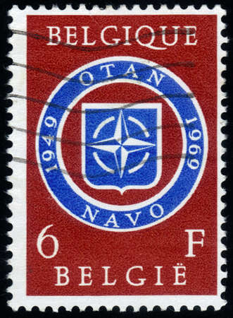 Belgium - CIRCA 1969  a stamp printed in Belgium celebrates the twentieth anniversary of NATO, the North Atlantic Treaty Organization  Belgium, circa 1969 Stock Photo - 14794646