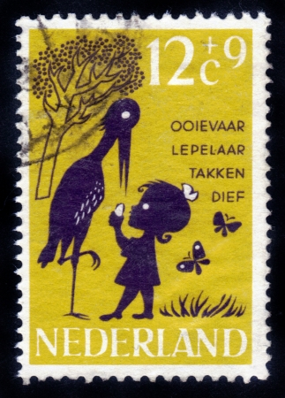 NETHERLANDS - CIRCA 1963  A stamp printed in the Netherlands shows an illustration of a child s poem about the stork and children, circa 1963  Stock Illustration - 14794651