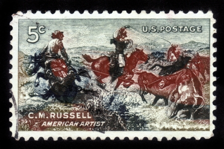 UNITED STATES - CIRCA 1964  A stamp printed in the United States , shows a picture of  Jerked Down  by Charles M  Russell , American artist  1864-1926 , circa 1964 photo
