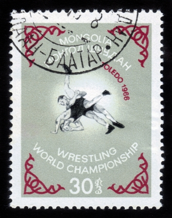 wrestlers: MONGOLIA - CIRCA 1966  a stamp printed in MONGOLIA shows two wrestlers with the inscription and name of series  Wrestling World Championship in Toledo , circa 1966 Stock Photo