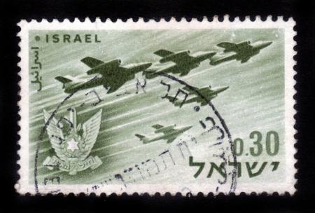 postal stamp: ISRAEL - CIRCA 1962  A stamp printed in Israel, shows a Israeli aircraft - bombers and military emblem - Israel s air force, Israel, series, circa 1962 Stock Photo