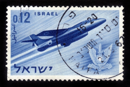 ISRAEL - CIRCA 1962  A stamp printed in Israel, shows a Israeli aircraft - fighter and military emblem - Israel s air force, Israel, series, circa 1962 Stock Photo - 14794667