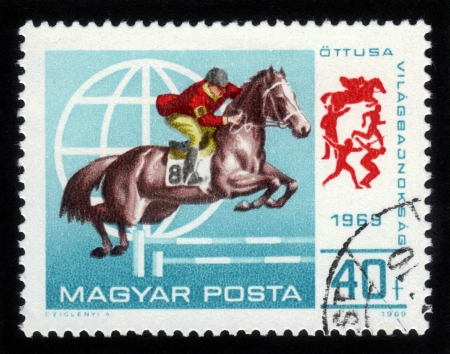 HUNGARY - CIRCA 1969  stamp printed by Hungary, shows an equestrian competition, circa 1969 Stock Photo - 14794680