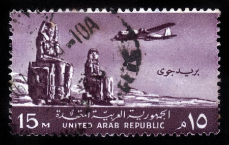 EGYPT - CIRCA 1959  stamp printed by Egypt   united arab republic   , shows Plane, Colossi of Memnon, Thebes, circa 1959 Stock Photo - 14794669