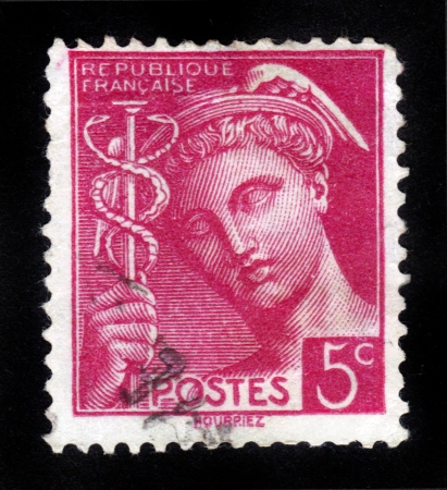 FRANCE - CIRCA 1938: A stamp printed in France shows the ancient Greek god - Mercury, circa 1938 photo