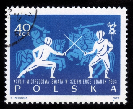 fencers: POLAND - CIRCA 1963  A stamp printed in Poland shows Fencers and knights in armor, circa 1963 Stock Photo
