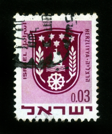 ISRAEL - CIRCA 1960: A stamp printed in Israel, shows coat of arms of Herzliya, Israel, series, circa 1960 Stock Photo - 14849111