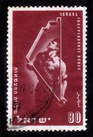ISRAEL - CIRCA 1951  stamp printed in Israel, shows an Israeli  worker  and a shape of the map of Israel , dedicated to Independence Bonds , circa 1951 Stock Photo - 14902457
