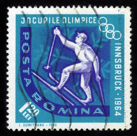 ROMANIA - CIRCA 1963  A stamp printed in Romania shows a ski competition on a Olympic Games in Innsbruck, Austria, circa 1963