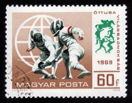 Hungary - CIRCA 1969  A stamp printed in Hungary shows a fencing competitions, circa 1969 Stock Photo - 14902461