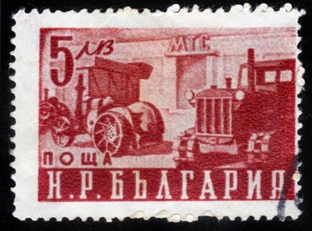 BULGARIA - CIRCA 1951: A stamp printed in Bulgaria shows first bulgarian tractor, circa 1951