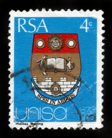 REPUBLIC OF SOUTH AFRICA - CIRCA 1973: A stamp printed in Republic of South Africa shows coat of arms of the university of the South Africa (Unisa), dedicated to the centenary, circa 1973 Stock Photo - 15004713