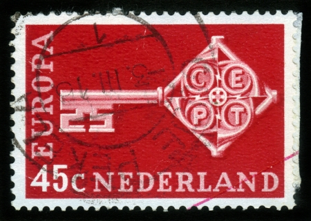 NETHERLANDS - CIRCA 1968  a stamp printed in the Netherlands shows Key with CEPT Emblem, Symbolizing Unity, European Community, circa 1968 Stock Photo - 15132760