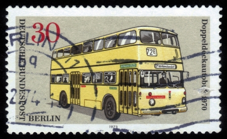 bundespost: FEDERAL REPUBLIC OF GERMANY - CIRCA 1973: A stamp printed in the Federal Republic of Germany shows double decker city bus 1970, circa 1973 Stock Photo