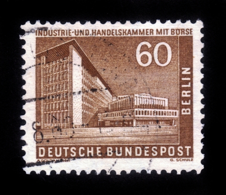 GERMANY - CIRCA 1957: A stamp printed in Germany (West Berlin), shows the building of Chamber of Commerce and Industry and Market in West Berlin , circa 1957 Stock Photo - 15319503