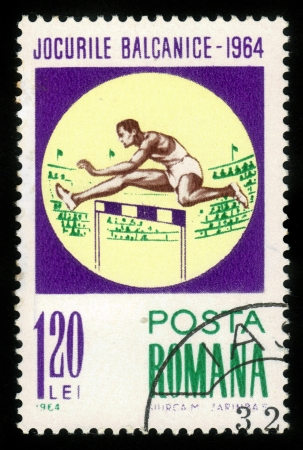 ROMANIA - CIRCA 1964: stamp printed by Romania, shows Hurdling, Balkan games ,circa 1964 Stock Photo - 15319505