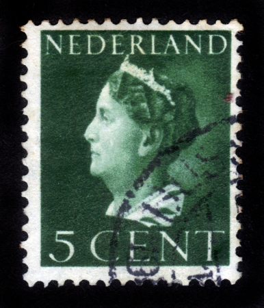 wilhelmina: NETHERLANDS - CIRCA 1947: A stamp printed in the Netherlands shows Queen Wilhelmina, series, circa 1947 Editorial