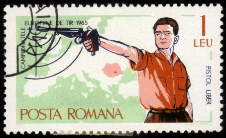 ROMANIA - CIRCA 1965: A stamp printed in the Romania, dedicated to the European Championship by shooting in Bucharest, shows a sportsman shooting a pistol, circa 1965