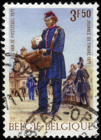 Belgium - CIRCA 1971: A post stamp printed in Belgium shows postman delivering mail and devoted Stamp Day, circa 1971