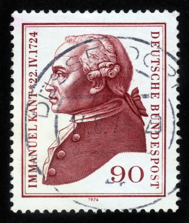 metaphysics: GERMANY- CIRCA 1974: A stamp printed by Germany shows Immanuel Kant (1724-1804), philosopher, founder of German classical philosophy , circa 1974