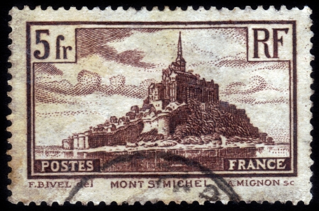FRANCE - CIRCA 1929: A stamp printed in France shows Abbey Mont St Michel, circa 1929 Stock Photo - 15438117