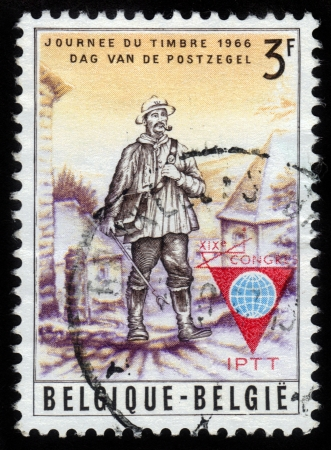 Belgium - CIRCA 1966: A post stamp printed in Belgium shows postman delivering mail and devoted Stamp Day, circa 1966 Stock Photo - 15438120