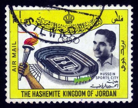 king hussein: JORDAN-CIRCA 1967: A stamp printed in Jordan shows image of King Hussein and stadium sports city, circa 1967. Editorial