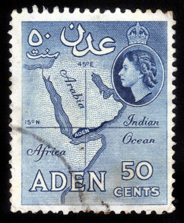 ADEN - CIRCA 1956: stamp printed in Aden shows a map of the Arabian Peninsula and the image of British Queen Elisabeth. Aden became a crown colony of the UK in 1954. Circa 1956 Stock Photo - 15438118